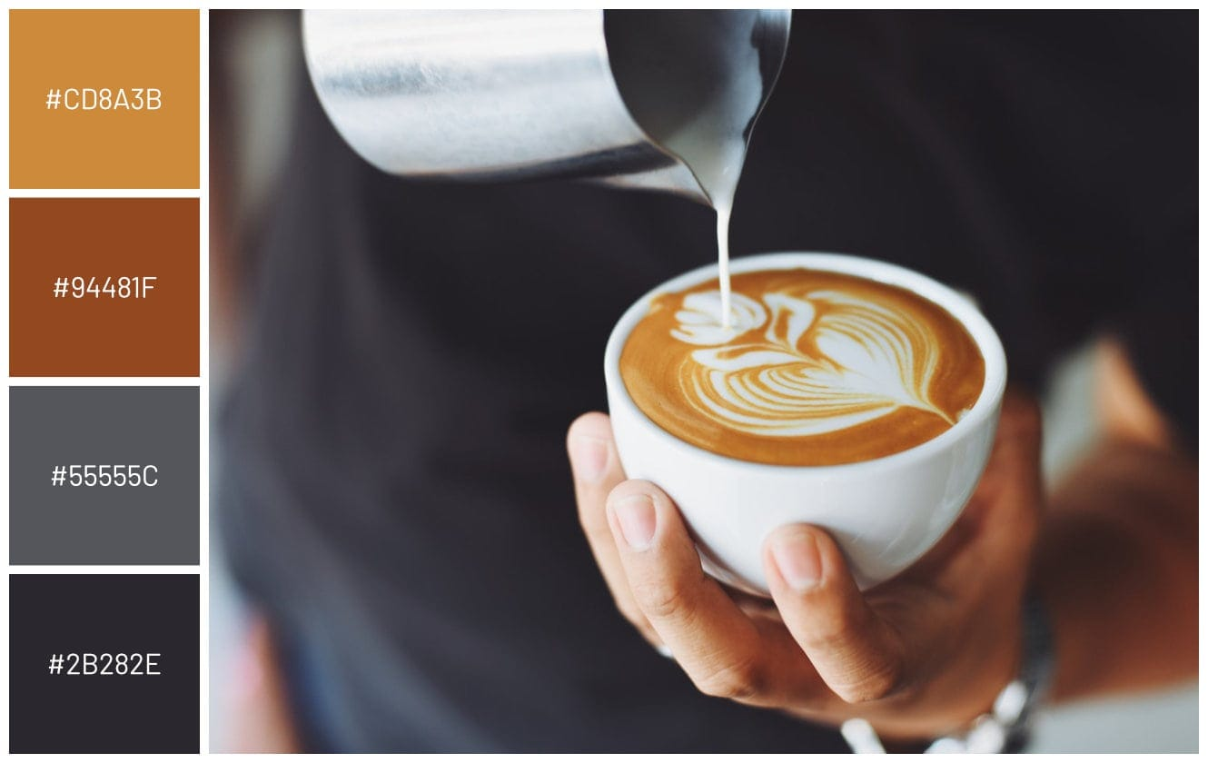 barista pouring flowr pattern into cappuccino art
