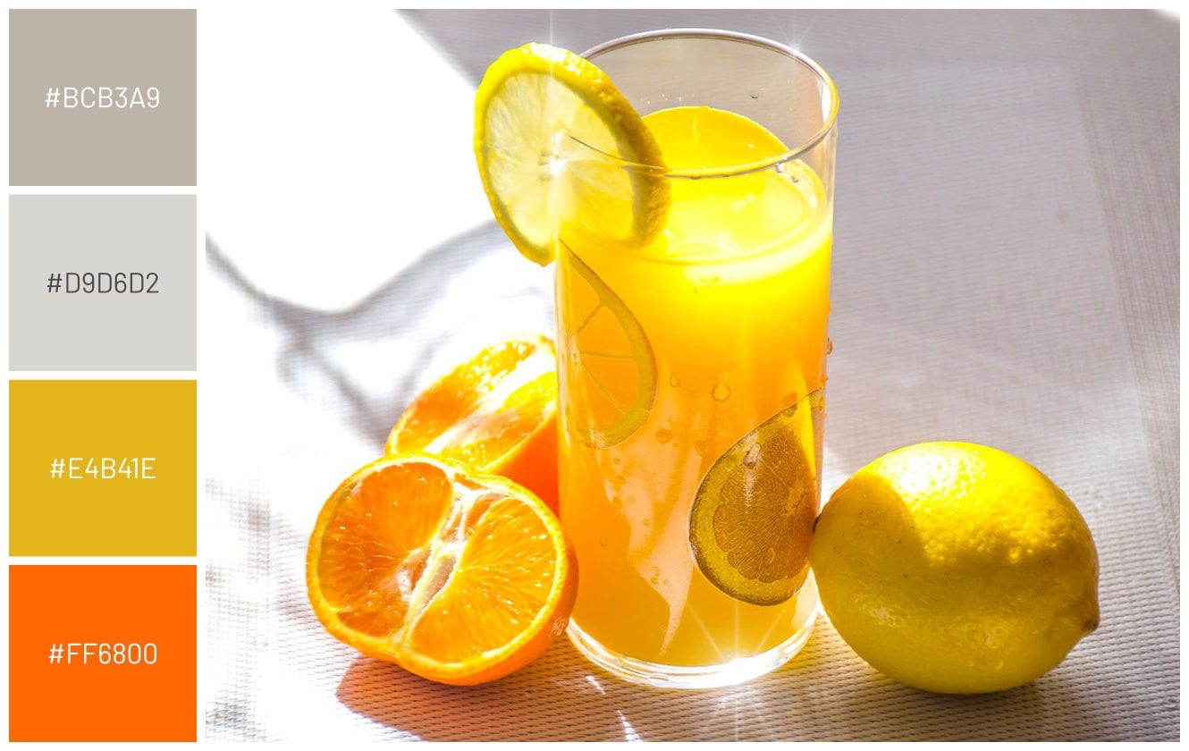 citrus beverage oranges lemons on grey table background