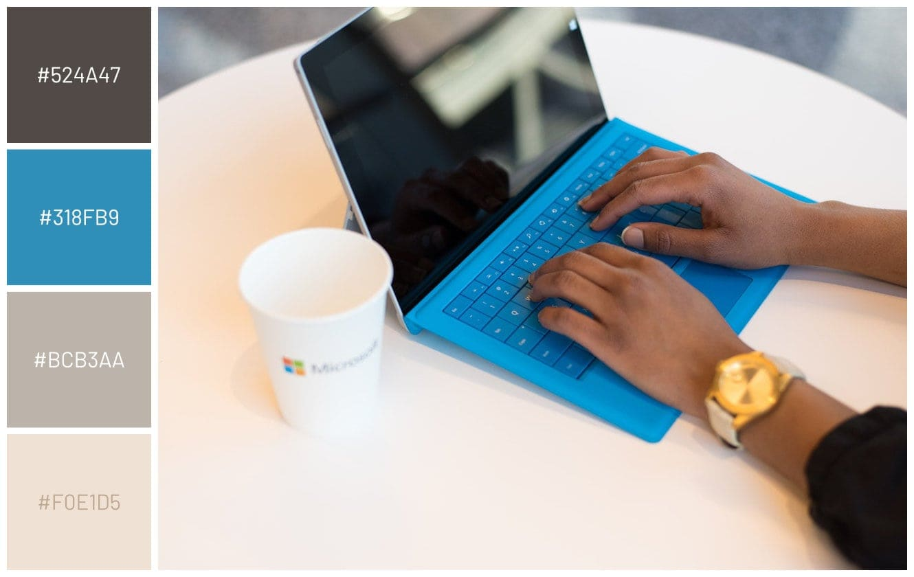 person using microsoft surface tablet with blue detachable keyboard